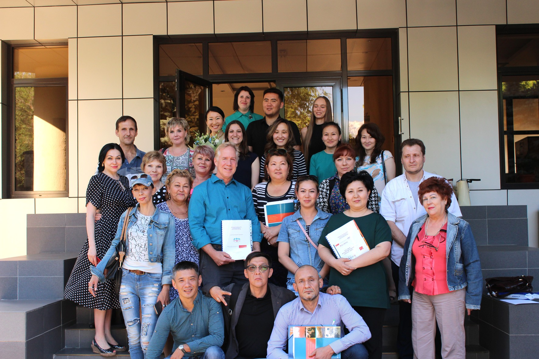 Photo of BRIDGE study trainees standing in a group in Almaty